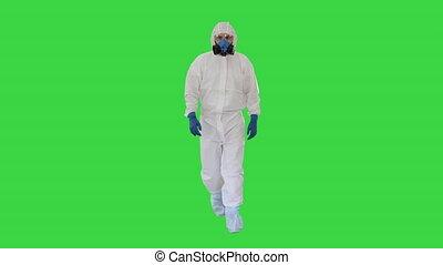 Man wearing hazmat suit walking on a Green Screen, Chroma Key.