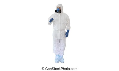 Wide shot. Medical doctor in hazamat clothes pointing on imaginary screen on white background. Professional shot in 4K resolution. 53. You can use it e.g. in your medical, commercial video, business, presentation, broadcast