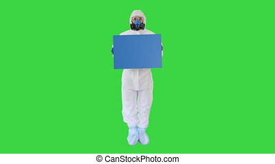 Wide shot. Mockup blue screen. Lab scientist in safety suit holding board on a Green Screen, Chroma Key. Professional shot in 4K resolution. 53. You can use it e.g. in your medical, commercial video, business, presentation, broadcast