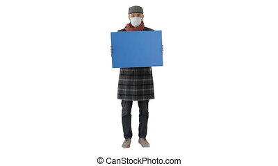 Wide shot. Mockup blue screen. Man in a trendy outfit and medical mask holding blank placard on white background. Professional shot in 4K resolution. 53. You can use it e.g. in your medical, commercial video, business, presentation, broadcast