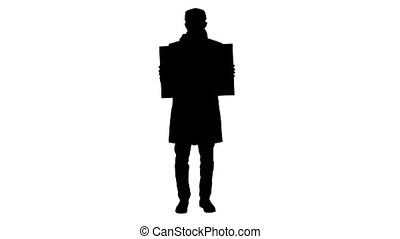 Wide shot. Mockup blue screen. Silhouette Man in a trendy outfit and medical mask holding blank placard. Professional shot in 4K resolution. 53. You can use it e.g. in your medical, commercial video, business, presentation, broadcast