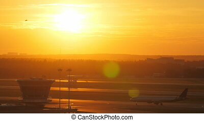 Wide shot of air traffic control tower at sunset - Aerial...