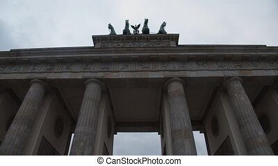 Wide Shot of going troiugh Brandenburg Gate, Brandenburger Tor in Berlin, Germany with Overcast Sky 4K