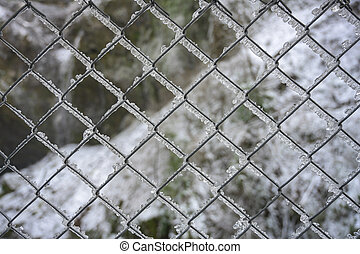 Wide Shot of Ice on Chain Link Fence