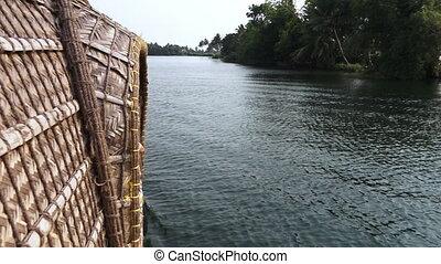 Wide shot of riverbank from ferry - Still, wide shot taken...