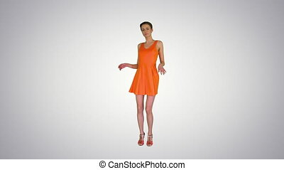 Wide shot. Short-haircutted pretty woman dancing in orange sundress on gradient background. Professional shot in 4K resolution. 023. You can use it e.g. in your commercial video, business, presentation, broadcast