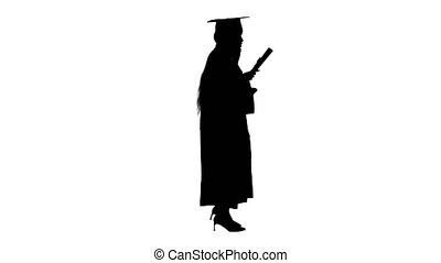 Wide shot. Side view. African American female student in graduation robe talking on the phone while walking, Alpha Channel Professional shot in 4K resolution. 046. You can use it e.g. in your medical, commercial video, business, presentation, broadcast