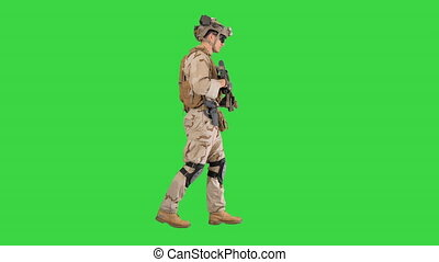 Wide shot. Side view. Armed Marine Soldier with rifle walking on a Green Screen, Chroma Key. Professional shot in 4K resolution. 048. You can use it e.g. in your medical, commercial video, business, presentation, broadcast