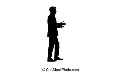 Bearded businessman walking and explaining something, Alpha ...