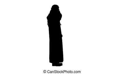 Wide shot. Side view. Emirate Arabian UAE Sheikh businessman making a call, Alpha Channel Professional shot in 4K resolution. 044. You can use it e.g. in your medical, commercial video, business, presentation, broadcast