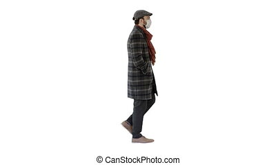 Gentleman wearing a protective face mask walking on white background.
