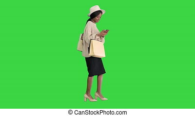 Happy African american fashion girl in knitted oversized ...