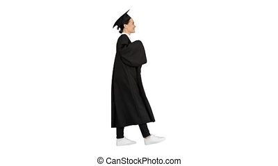 Wide shot. Side view. Happy female student in graduation robe walking and cheering with her diploma on white background. Professional shot in 4K resolution. 043. You can use it e.g. in your medical, commercial video, business, presentation, broadcast