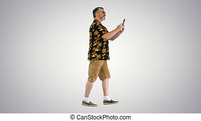 Happy senior bearded tourist man walking and taking pictures...