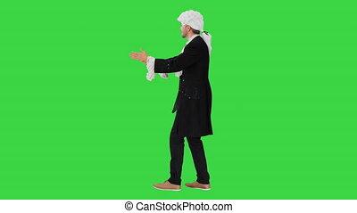 Man dressed like Wolfgang Amadeus Mozart conducting an ...
