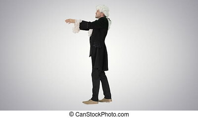 Wide shot. Side view. Man in 18th century embroidered suit conducting Looking like Mozart on gradient background. Professional shot in 4K resolution. 4151. You can use it e.g. in your commercial video, business, presentation, broadcast