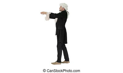 Wide shot. Side view. Man in 18th century embroidered suit conducting Looking like Mozart on white background. Professional shot in 4K resolution. 4151. You can use it e.g. in your commercial video, business, presentation, broadcast