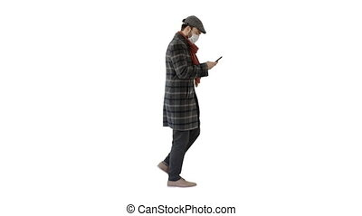 Man in medical mask walking and using mobile phone on white background.