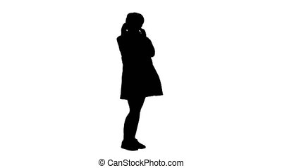 Wide shot. Side view. Pregnant woman standing and listening dancing music in headphones, Alpha Channel Professional shot in 4K resolution. 050. You can use it e.g. in your medical, commercial video, business, presentation, broadcast