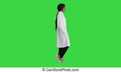 Pretty african american female doctor posing on a Green Screen, Chroma Key.