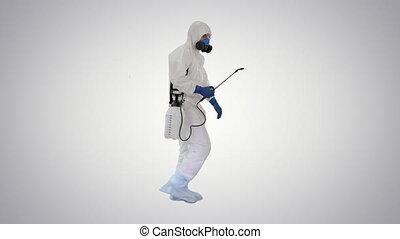 Scientist in hazmat suit walking and disinfecting against ...