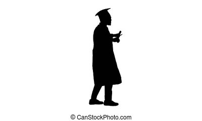 Wide shot. Side view. Silhouette Excited african american male student in graduation robe dancing with his diploma while walking. Professional shot in 4K resolution. 051. You can use it e.g. in your medical, commercial video, business, presentation, broadcast