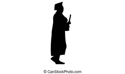 Wide shot. Side view. Silhouette Happy female student in graduation robe talking emotionally on the phone while walking with diploma. Professional shot in 4K resolution. 043. You can use it e.g. in your medical, commercial video, business, presentation, broadcast