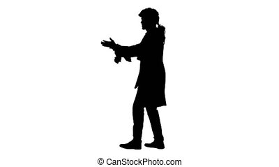 Wide shot. Side view. Silhouette Man dressed like Wolfgang Amadeus Mozart conducting an orchestra. Professional shot in 4K resolution. 047. You can use it e.g. in your medical, commercial video, business, presentation, broadcast