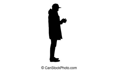 Wide shot. Side view. Silhouette Man in winter clothes using sanitizer spray to prevent flu disease. Professional shot in 4K resolution. 53. You can use it e.g. in your medical, commercial video, business, presentation, broadcast