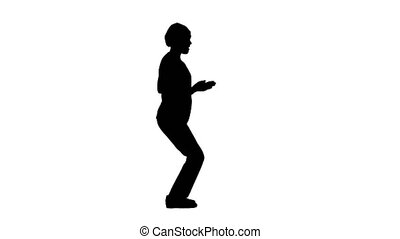 Wide shot. Side view. Silhouette Pretty dancing doctor in blue uniform. Professional shot in 4K resolution. 043. You can use it e.g. in your medical, commercial video, business, presentation, broadcast