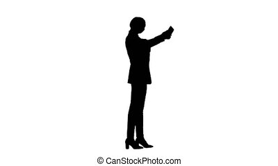 Wide shot. Side view. Silhouette Smiling Businesswoman taking selfie on her phone. Professional shot in 4K resolution. 043. You can use it e.g. in your medical, commercial video, business, presentation, broadcast