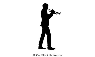 Wide shot. Side view. Silhouette Stylish jazz man walking and playing the trumpet. Professional shot in 4K resolution. 047. You can use it e.g. in your medical, commercial video, business, presentation, broadcast