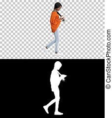 Smiling african american woman using tablet pc while walking, Al