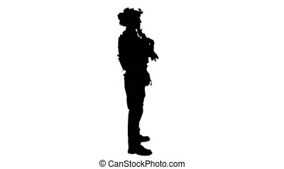 Wide shot. Side view. Soldier with machine gun standing, Alpha Channel Professional shot in 4K resolution. 048. You can use it e.g. in your medical, commercial video, business, presentation, broadcast