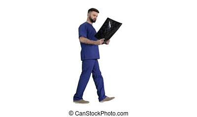 Wide shot. Side view. Surgeon studying mri brain scan while walking on white background. Professional shot in 4K resolution. 044. You can use it e.g. in your medical, commercial video, business, presentation, broadcast