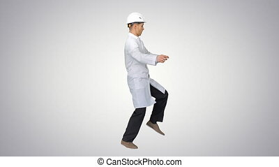 Young workman with helmet in white robe enjoy dancing on ...