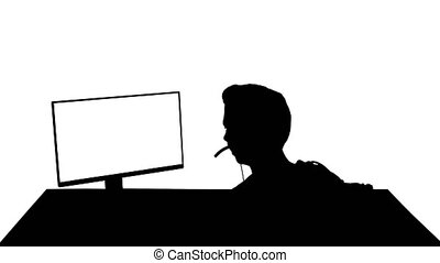 Silhouette Back shot of competitive young man playing online...