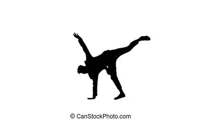 Silhouette Businessman in suit does break dance moves.