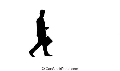 Silhouette Handsome suspicious businessman walking by with a...