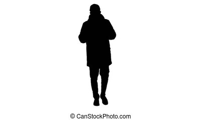 Wide shot. Silhouette Man in winter outfit and medical mask talking to you explaining something while walking. Professional shot in 4K resolution. 53. You can use it e.g. in your medical, commercial video, business, presentation, broadcast