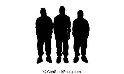 Wide shot. Silhouette Three doctors in protective clothes fold hands. Team work. Professional shot in 4K resolution. 53. You can use it e.g. in your medical, commercial video, business, presentation, broadcast