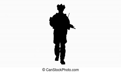 Wide shot. Silhouette US Army soldier in combat uniform walking. Professional shot in 4K resolution. 4151. You can use it e.g. in your commercial video, business, presentation, broadcast