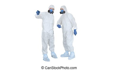 Wide shot. Three men in protective uniform enter the frame one after another. Disinfection needed Doctor in protective uniform calls his colleagues for help on white background. Professional shot in 4K resolution. 53. You can use it e.g. in your medical, commercial video, business, presentation, ...