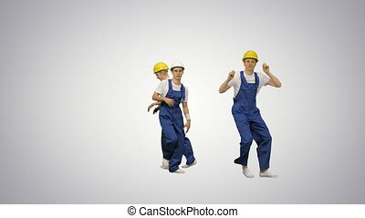 Group of builders walk in the frame and dance on gradient background.