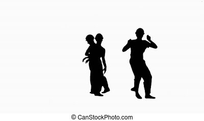 Silhouette Group of builders walk in the frame and dance.