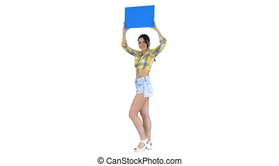 Wide shot. Walking in and out of the frame. Girl with an empty board announcing new round on white background. Professional shot in 4K resolution. 021. You can use it e.g. in your commercial video, business, presentation, broadcast