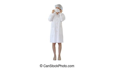 Wear the mask! Female doctor wearing a mask and pointing her finger up on white background.
