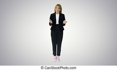 Young business woman presenting something pointing at virtual ob
