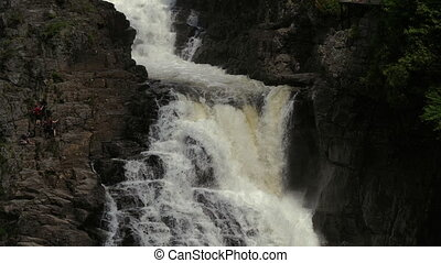 Canyon Sainte Anne Waterfall. People gliding on the cliff. -...