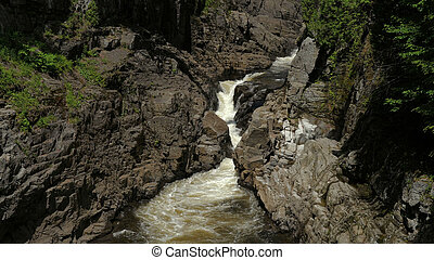 Wide shot.Canyon Sainte-Anne Waterfall, Quebec Canada Professional shot in 4K resolution. 02. You can use it e.g. in your commercial video, medical, business, presentation, broadcast